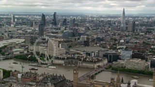 AX115_255 - 6K stock footage aerial video of skyscrapers in Central London, London Eye and Parliament, England