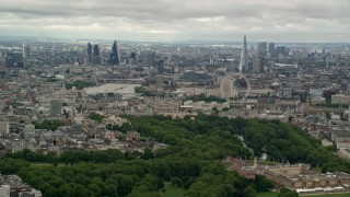 AX115_264 - 6K stock footage aerial video the London cityscape seen from Buckingham Palace, England