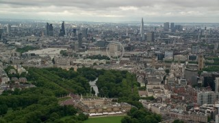 AX115_265 - 6K stock footage aerial video of the city of London seen while passing Buckingham Palace, England