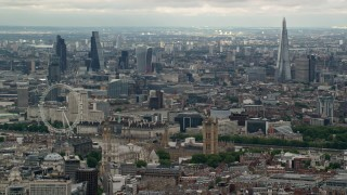 AX115_268 - 6K stock footage aerial video of the London cityscape, including Big Ben, Parliament, London Eye, England