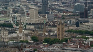 AX115_270 - 6K stock footage aerial video of flying by Big Ben, Parliament and London Eye, England