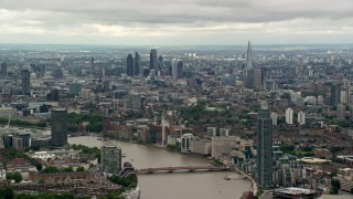 AX115_272 - 6K stock footage aerial video of Central London skyscrapers seen from near MI6 Building, England