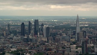 AX115_274 - 6K stock footage aerial video of skyscrapers in Central London near The Shard, England