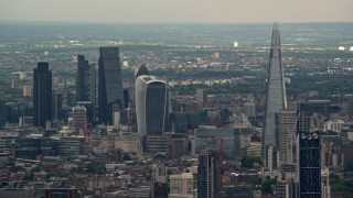 AX115_275 - 6K stock footage aerial video of Central London skyscrapers, The Shard and Strata in foreground, England