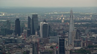 AX115_276 - 6K stock footage aerial video of Central London skyscrapers, The Shard, and Strata, England