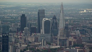 AX115_279 - 6K stock footage aerial video of tall Central London Skyscrapers near The Shard, England