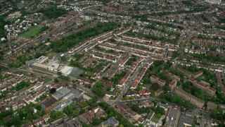 AX115_280 - 6K stock footage aerial video fly over residential neighborhoods, London, England
