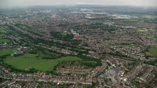 AX115_283 - 6K stock footage aerial video fly over residential area near Norbury Park, London, England