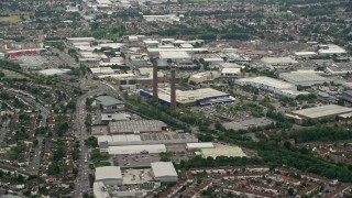 AX115_287 - 6K stock footage aerial video of smoke stacks at the Valley Park Retail Area, Croydon, England