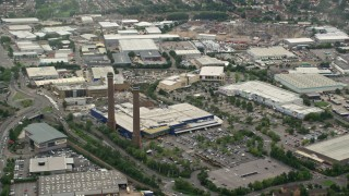 AX115_288 - 6K stock footage aerial video of smoke stacks by Valley Park Retail Area, Croydon, England