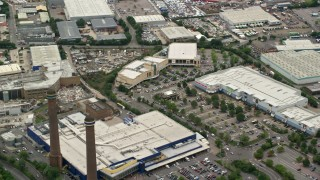 AX115_289 - 6K stock footage aerial video of flying over the Valley Park Retail Area, Croydon, England