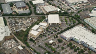 AX115_290 - 6K stock footage aerial video fly over shops at the Valley Park Retail Area, Croydon, England