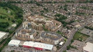 AX115_291 - 6K stock footage aerial video of orbiting a condominium complex, Croydon, England