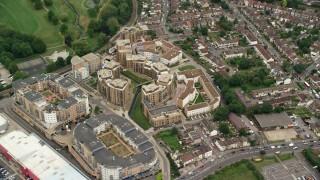 AX115_292 - 6K stock footage aerial video of an orbit of a condominium complex, Croydon, England