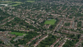 AX115_293 - 6K stock footage aerial video of orbiting a residential neighborhood, Wallington, England