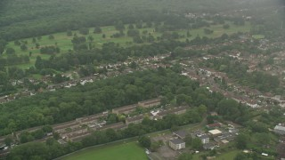 AX115_302 - 6K stock footage aerial video flyby row houses and suburban homes, Coulsdon, England