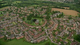 AX115_307 - 6K stock footage aerial video of orbiting rural village surrounded by farmland, Coulsdon, England