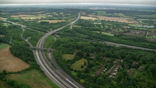AX115_309 - 6K stock footage aerial video of M23 and M25 freeway interchange in Redhill, England