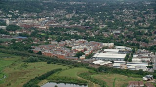 AX115_312 - 6K stock footage aerial video of apartment buildings and warehouses, Redhill, England