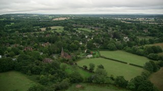AX115_318 - 6K stock footage aerial video of village homes with trees, Redhill, England