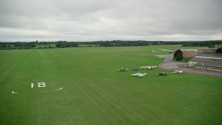 AX115_319 - 6K stock footage aerial video of landing at an airport in Redhill, England