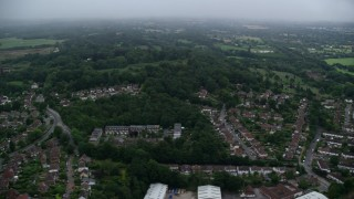 AX116_002 - 6K stock footage aerial video of flying by homes in Redhill, England, twilight