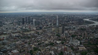 AX116_009 - Aerial stock footage of Skyscrapers, River Thames and Central London cityscape, England, twilight