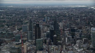 AX116_011 - 6K stock footage aerial video of Heron Tower, Tower 42, The Gherkin, Leadenhall skyscrapers, London, England, twilight