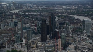 AX116_012 - 6K stock footage aerial video orbit Central London skyscrapers, reveal 20 Fenchurch Street, London, England, twilight