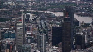 AX116_013 - 6K stock footage aerial video of orbiting Central London skyscrapers, London, England, twilight