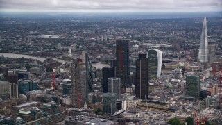 AX116_015 - 6K stock footage aerial video orbit skyscrapers, The Shard near River Thames, London, England, twilight