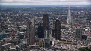 AX116_016 - 6K stock footage aerial video of skyscrapers, with The Shard in distance, London, England, twilight