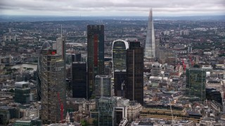 AX116_017 - 6K stock footage aerial video approach skyscrapers, with The Shard in the distance, London England, twilight