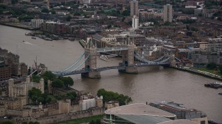 AX116_020 - 6K stock footage aerial video of flying by Tower Bridge spanning the River Thames in London, England, twilight