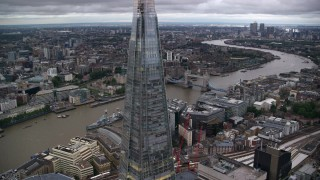 AX116_023 - 6K stock footage aerial video of flying away from The Shard skyscraper and River Thames in London, England, twilight