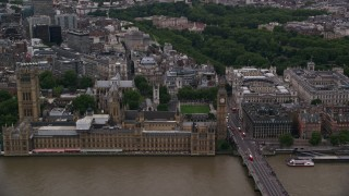 AX116_026 - 6K stock footage aerial video approach British Parliament, Big Ben, and Westminster Abbey, London, England, twilight