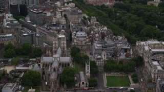 AX116_027 - 6K stock footage aerial video fly over Westminster Abbey toward Westminster Central Hall, London, England, twilight
