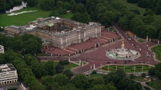 AX116_029 - 6K stock footage aerial video of approaching Buckingham Palace and Victoria Memorial, London, England, twilight