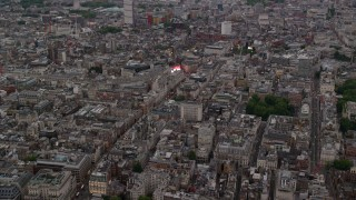 AX116_031 - 6K stock footage aerial video of flying by Piccadilly Circus, London, England, twilight