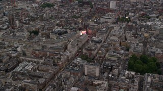 AX116_032 - 6K stock footage aerial video of approaching Piccadilly Circus in London, England, twilight