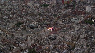 AX116_033 - 6K stock footage aerial video of passing by Piccadilly Circus in London, England, twilight
