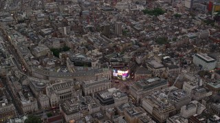 AX116_034 - 6K stock footage aerial video of orbiting Piccadilly Circus in London, England, twilight