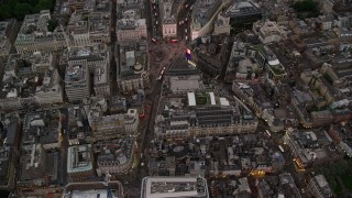 AX116_037 - 6K stock footage aerial video of a bird's eye view of Piccadilly Circus, London, England, twilight
