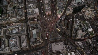 AX116_038 - 6K stock footage aerial video of a bird's eye view over Piccadilly Circus and double decker buses, London, England, twilight