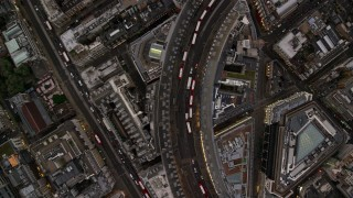 AX116_040 - 6K stock footage aerial video of a bird's eye view over Regent Street and double decker buses, London, England, twilight