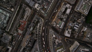 AX116_041 - 6K stock footage aerial video of a bird's eye view of double decker buses on Regent Street in London, England, twilight