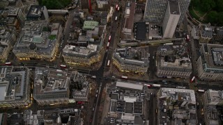 AX116_043 - 6K stock footage aerial video of a bird's eye view of Oxford Circus shops in London, England, twilight