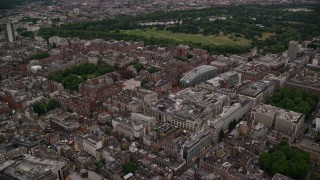 AX116_045 - 6K stock footage aerial video of flying by office Buildings and Park House near Grosvenor Square, London, England, twilight