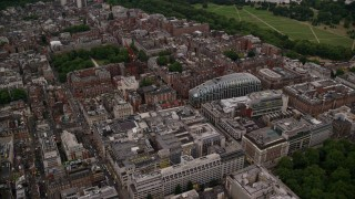 AX116_046 - 6K stock footage aerial video orbit office buildings and Park House near Grosvenor Square, London, England, twilight
