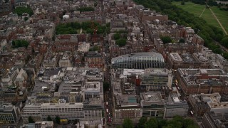 AX116_047 - 6K stock footage aerial video an orbit of office buildings, Park House near Grosvenor Square, London, England, twilight
